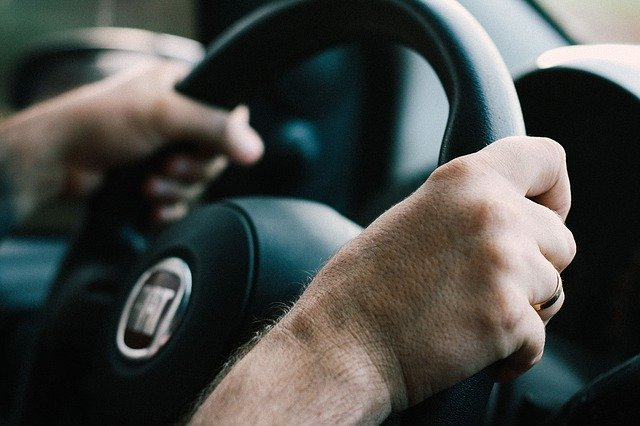 two hands on steering wheel
